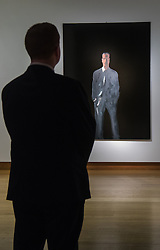 "Christies, St James, London, February 5th 2016. A man admires Michelangelo Pistoletto's ""Il Presente. Figura su sfondo nero V (The Present. Figure on a Black Ground V)"", which is expected to fetch up to £550,000 at auction, during the 20th Century Art Sale Preview. ///FOR LICENCING CONTACT: paul@pauldaveycreative.co.uk TEL:+44 (0) 7966 016 296 or +44 (0) 20 8969 6875. ©2015 Paul R Davey. All rights reserved."