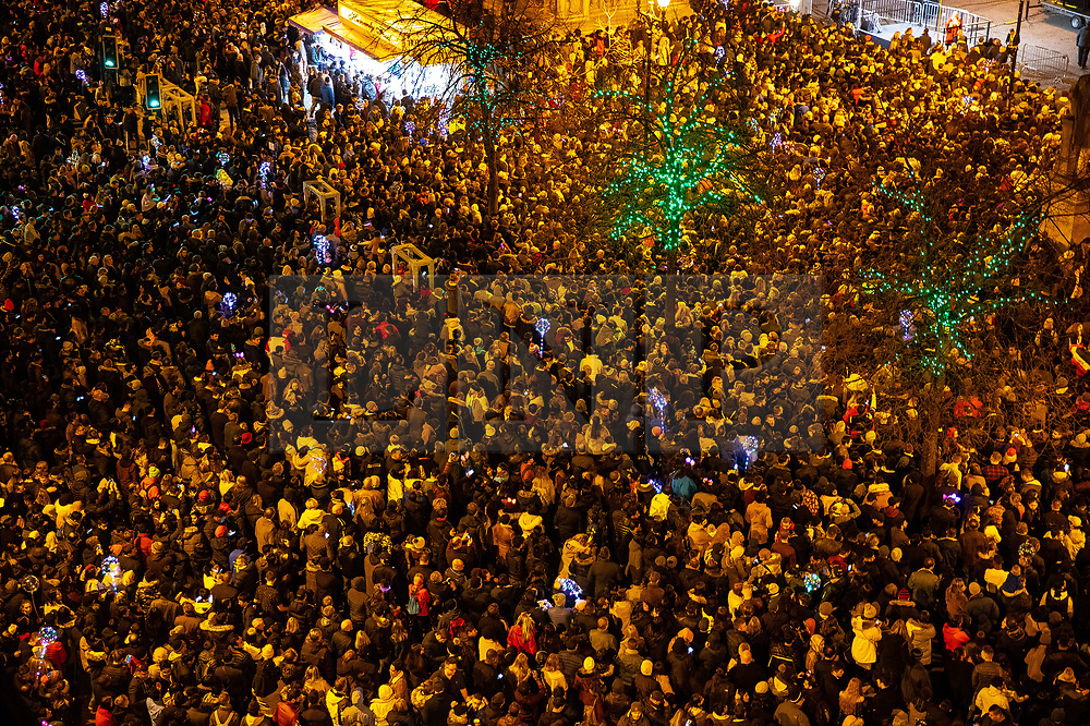 © Licensed to London News Pictures . FILE PICTURE DATED 31/12/2018 of thousands gathered in Albert Square in Manchester City Centre as Mahdi Mohamud is due to appear at Manchester Crown Court today (Tuesday 26 November 2019) charged  with 3 counts of attempted murder and 1 count contrary to Section 58 (1) (a), TACT 2000 which relates to the possession of a document or record likely to be useful to a person committing or preparing an act of terrorism . On the evening of 31st December 2018 , as thousands headed in to Manchester City Centre to watch New Years Day fireworks , three people including a British Transport Police Officer were stabbed and a man was tasered on a Metrolink platform of Victoria Train Station in Manchester . Photo credit : Joel Goodman/LNP