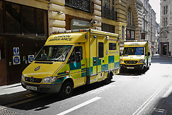 © Licensed to London News Pictures. 25/03/2017. London, UK. Ambulances on standby, on a back street in Piccadilly, central London ahead of a Unite for Europe march through Westminster today (Sat). There is much heightened security around Westminster, following a terror attack earlier in the week in which a lone man drove a car over Westminster Bridge, killing and injuring dozens of members of the public, before attacking and killing a police officer. Photo credit: Peter Macdiarmid/LNP