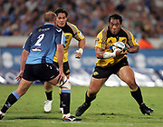 Hurricanes prop Neemia Tialata looks to side step Gary Botha during the Super 14 rugby union match between the Bulls and Hurricanes at Loftus Pretoria, South Africa, on Friday 17 March, 2006. The Hurricanes won the match 26-23. Photo: Africa Visuals/PHOTOSPORT **NZ USE ONLY**<br /> <br /> <br /> 149907