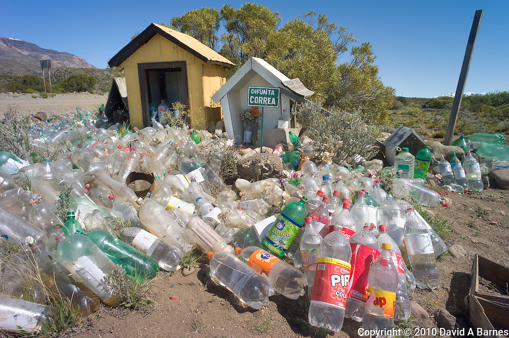 Difunta Correa roadside alter with empty bottles filled with water as offing, Patagonia, Chile