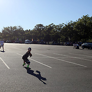 A youngster plays catch in the car park before the New York Mets Vs New York Yankees MLB regular season baseball game at Citi Field, Queens, New York. USA. 20th September 2015. Photo Tim Clayton