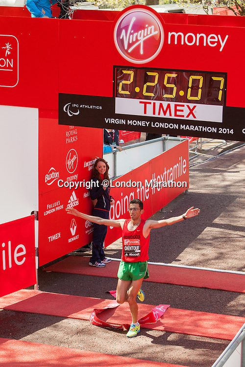 El Amin Chentouf crosses the finishing line in a time of 02:24:00 to win the IPC Mens T11-13 race at the Virgin Money London Marathon 2014 at the finish line on Sunday 13 April 2014<br /> Photo: Dillon Bryden/Virgin Money London Marathon<br /> media@london-marathon.co.uk