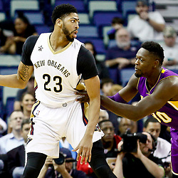 Nov 29, 2016; New Orleans, LA, USA; New Orleans Pelicans forward Anthony Davis (23) is defended by Los Angeles Lakers forward Julius Randle (30) during the first quarter of a game at the Smoothie King Center. Mandatory Credit: Derick E. Hingle-USA TODAY Sports
