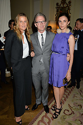 Left to right, INDIA HICKS, ASHLEY HICKS and his wife KATA DE SOLLIS at a party to kick off London Fashion Week hosted by US Ambassador Matthew Barzun and Mrs Brooke Brown Barzun with Alexandra Shulman in association with J.Crew hrld at Winfield House, Regent's Park, London on 18th September 2015.