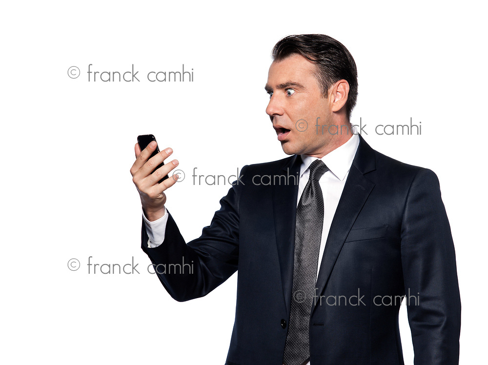 handsome caucasian man looking at phone stun portrait isolated studio on white background