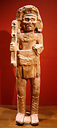 Maya Deity. 9th century, limestone. This towering sculpture of the Maya god Chahk - an able warrior and an embodiment of rain, thunder and lightening - guarded a royal building. His multiple roles are indicated by the axe he raises menancingly in his right hand.