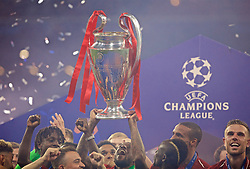 MADRID, SPAIN - SATURDAY, JUNE 1, 2019: Liverpool's Georginio Wijnaldum lifts the trophy after the UEFA Champions League Final match between Tottenham Hotspur FC and Liverpool FC at the Estadio Metropolitano. Liverpool won 2-0 tp win their sixth European Cup. (Pic by David Rawcliffe/Propaganda)