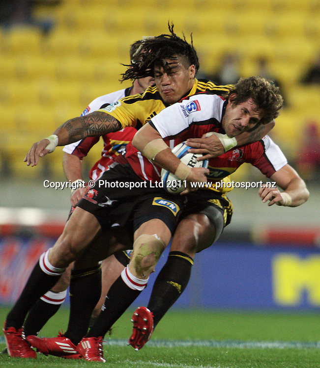 Ma'a Nonu tackles Dylan Des Fountain. Super 15 rugby match - Hurricanes v Lions at Westpac Stadium, Wellington, New Zealand on Saturday, 4 June 2011. Photo: Dave Lintott / photosport.co.nz