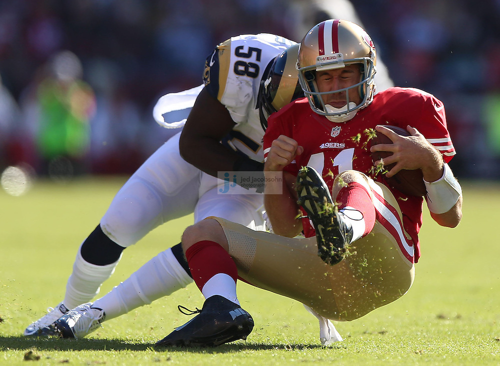 San Francisco 49ers quarterback Alex Smith (11) is tackled by St. Louis Rams linebacker Jo-Lonn Dunbar (58), Sunday, Nov. 11, 2012 at Candlestick Park, in San Francisco, Ca. (AP Photo/Jed Jacobsohn)