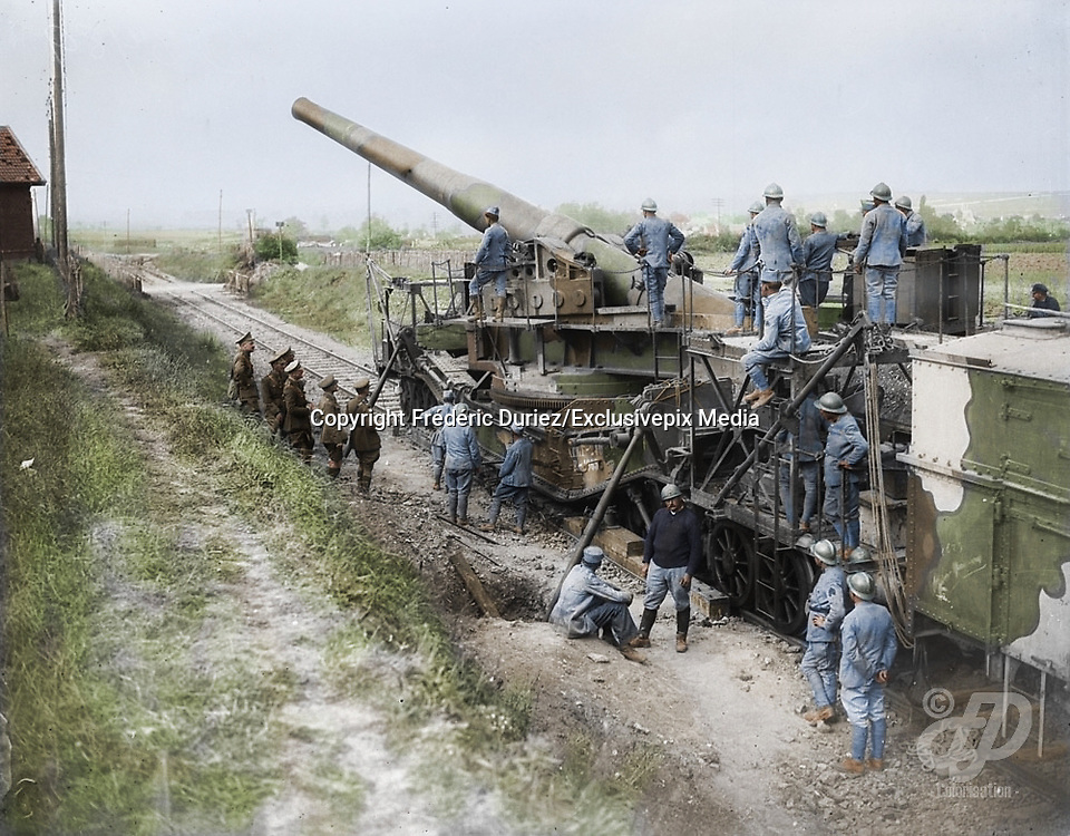 "Colorized photographs soldiers from the World War One<br /> <br /> With his impressive colorized photographs of the World War One, Frédéric Duriez gives us a new look at the conflict that ravaged the world between 1914 and 1918, revealing the difficult daily life of the French soldiers. <br /> <br /> Photo Shows: ""Canadian officers interested in a large French gun mounted on railroad. October, 1917.Credit: Canada. Dept. of National Defence/Library and Archives Canada.<br /> ©Frédéric Duriez/Exclusivepix Media"