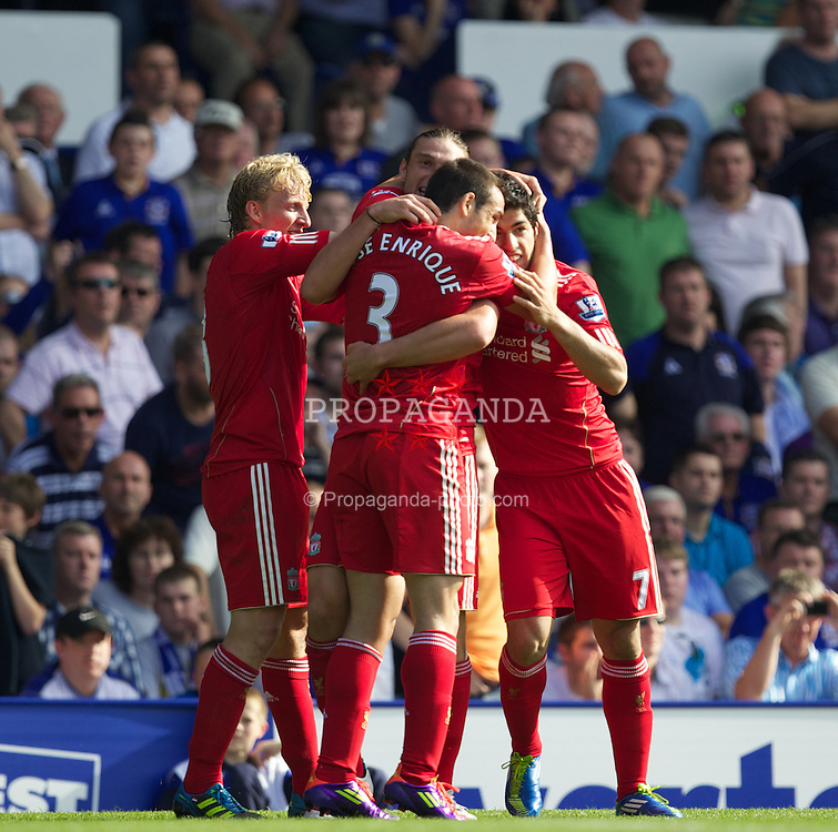LIVERPOOL, ENGLAND - Saturday, October 1, 2011: Liverpool's Andy Carroll celebrates scoring the first goal against against Everton with team-mate Dirk Kuyt, Jose Enrique and Luis Alberto Suarez Diaz during the Premiership match at Goodison Park. (Pic by Vegard Grott/Propaganda)