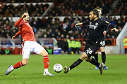 Charlton Athletic striker Tomer Hemed  wins a tackle with against Nottingham Forest defender Carl Jenkinson during the EFL Sky Bet Championship match between Nottingham Forest and Charlton Athletic at the City Ground, Nottingham, England on 11 February 2020.