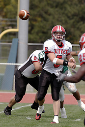 09 September 2006 Comet QB Calvin McNamara lets loose with a pass..In the first ever football competition between the Olivet Comets and the Illinois Wesleyan Titans, the Titans strut off the field with a 21- 6 victory. .Game action took place at Wilder Field on the campus of Illinois Wesleyan University in Bloomington Illinois.