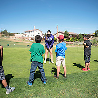 Mariana Chamberlin teaches a group of clinic students how to putt during the Gallup Junior Golf Clinic, Wednesday, June 12 at Fox Run Golf Course in Gallup.