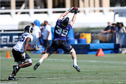 Los Angeles Rams rookie fullback Sam Rogers (39) is covered by a defender as he leaps and catches a pass during the Los Angeles Rams NFL football training camp practice on Saturday, July 29, 2017 in Irvine, Calif. (©Paul Anthony Spinelli)