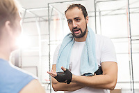 Man talking to male friend in crossfit gym