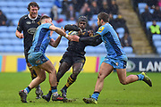 Wasps wing Christian Wade (14) is tackled during the Aviva Premiership match between Wasps and London Irish at the Ricoh Arena, Coventry, England on 4 March 2018. Picture by Dennis Goodwin.