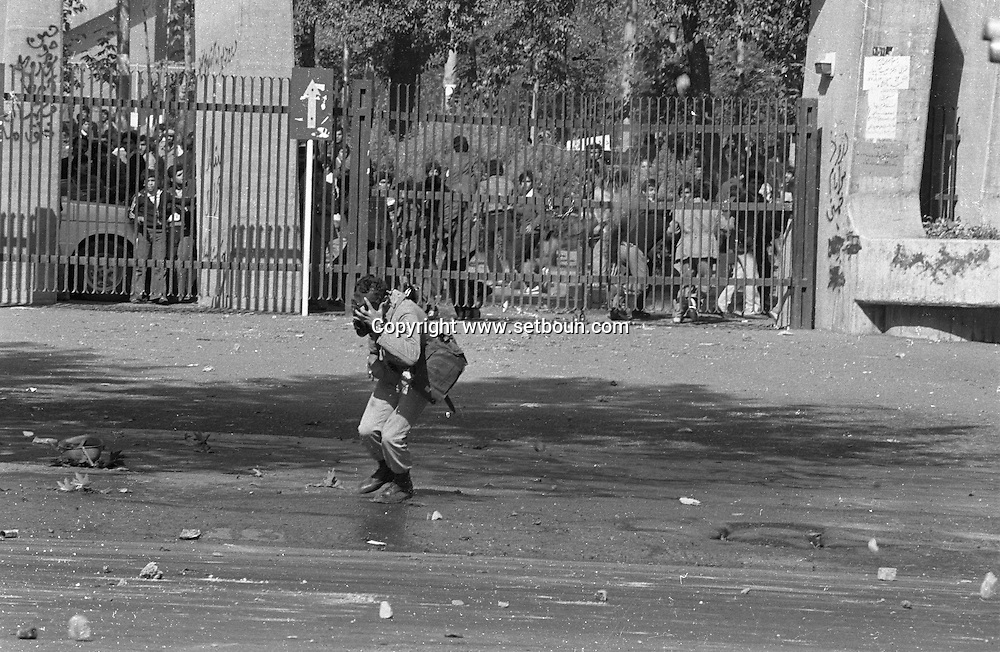 Iran - 1978 nov 4th  university campus , demonstrations, riots, fighting against the army, starting nov 4th 1978   Teharan  Iran  The aftermath of a riot in Tehran during the Iranian Revolution, 4th November 1978. Protestors took to the streets, looting and burning government buildings, banks, cinemas, alcoholic drink stores, hotels and cabarets. The army did not intervene +