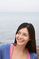 Young woman on beach smiling
