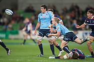 Matt Lucas (Waratahs) sends a long pass during the Round 15 match of the 2013 Super Rugby Championship between RaboDirect Rebels vs HSBC Waratahs at AAMI Park, Melbourne, Victoria, Australia. 24/05/0213. Photo By Lucas Wroe