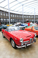 A 1963 Alfa Romeo 2600 Touring Spider<br /> in the Classic Remise, Dusseldorf.  The Classic Remise in a center for  vintage autos in what was a round house for train locomotives.<br /> Photo by Dennis Brack