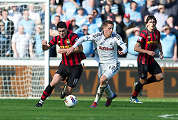 SWANSEA, WALES - Sunday, March 11, 2012: Manchester City's Gareth Barry in action against Swansea City's Gylfi Sigurdsson during the Premiership match at the Liberty Stadium. (Pic by David Rawcliffe/Propaganda)