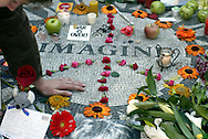 Visitors gather near a mosaic circle with the word Imagine on it to honor deceased Beatle John Lennon in New York December 8, 2005. Lennon was shot and killed by Mark Davd Chapman in front of his apartment twenty five years ago today. Keith Bedford