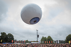 © Licensed to London News Pictures . 20/07/2013 . Suffolk , UK . A gigantic inflatable eyeball is launched in to the crowd as Yeah Yeah Yeahs perform on the Obelisk Stage . The Latitude music and culture festival in Henham Park , Southwold . Photo credit : Joel Goodman/LNP