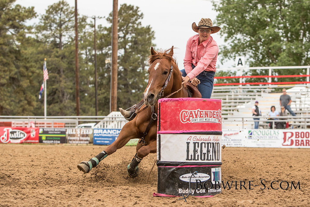 Amy Van Pelt makes her barrel racing run during slack at the Elizabeth Stampede on Sunday, June 3, 2018.