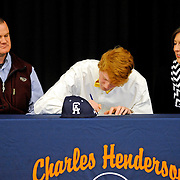 Charles Henderson High School's John Michael Stephens signs a scholarship to play baseball at Central Alabama Community College during a ceremony at the high school in Troy, Ala., Wednesday, Jan. 15, 2014. With Stephens are his parents, Buford and Monica. (Photo/Thomas Graning)