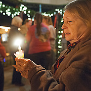 A participants holds a candle during a candlelight vigil in memory of Zoe Post in Troy, Ala., Monday, Dec. 15, 2014. Family, friends and community members gathered to honor the memory of Post on her birthday. Post died two years ago. David Post, Zoe's father, said they were 'remembering her life' and raising awareness of the effects of bullying. (Photo/Thomas Graning)