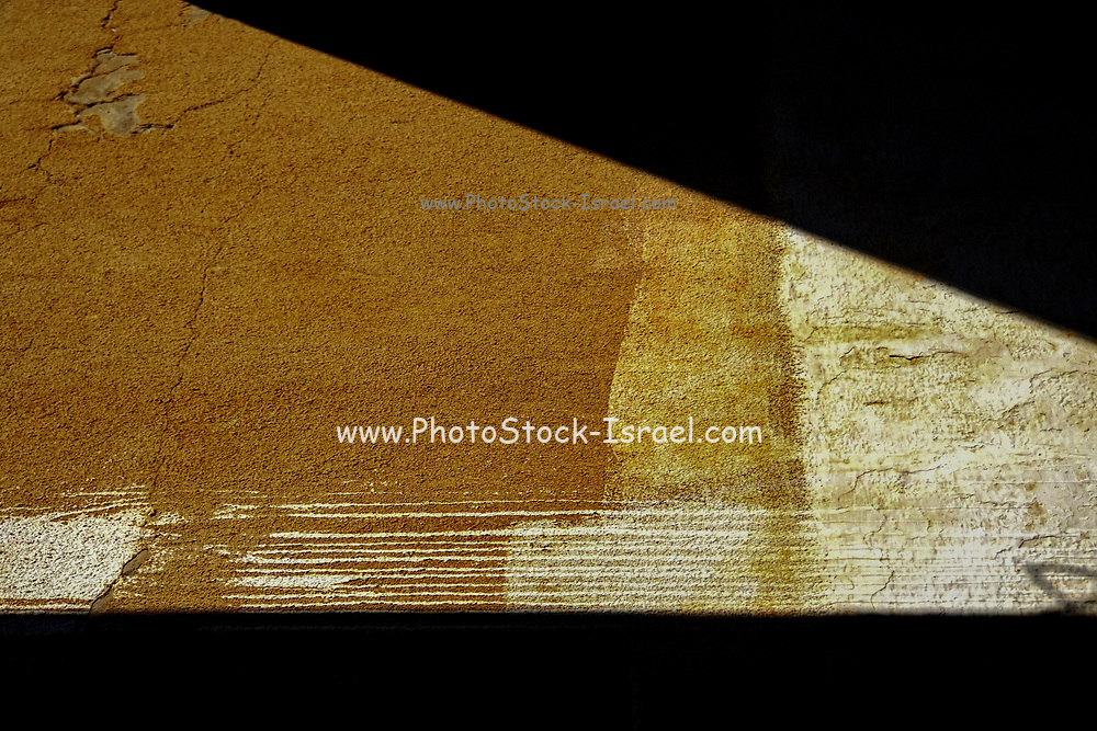 triangle of  Light enters a window in an old deserted and dilapidated building. Photographed in Abu Gosh, Israel