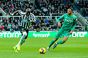 Mohamed Diame (#10) of Newcastle United drives forward into the penalty area followed by Etienne Capoue (#29) of Watford the Premier League match between Newcastle United and Watford at St. James's Park, Newcastle, England on 3 November 2018.