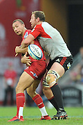 Quade Cooper pops a pass while caught in a tackle ~ Super 15 rugby (Round 15) - Reds v Crusaders played at Suncorp Stadium, Brisbane, Australia on Sunday 29th May 2011 ~ Photo : Steven Hight (AURA Images) / Photosport