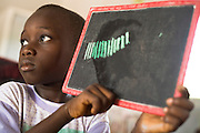 Boy showing chalk board with answer from a math problem at the Essaout primary school in the village of Essaout, Senegal, on Thursday June 14, 2007...