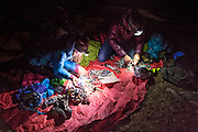 Kate Rutherford & Madaleine Sorkin checking the topo and sorting gear by headlamp the night before a climb in the Black Canyon of the Gunnison.