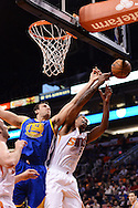 Dec 15, 2013; Phoenix, AZ, USA; Golden State Warriors center Andrew Bogut (12) goes up for a reboud against the Phoenix Suns forward Channing Frye (8) in the first half at US Airways Center. The Suns defeated the Warriors 106-102. Mandatory Credit: Jennifer Stewart-USA TODAY Sports
