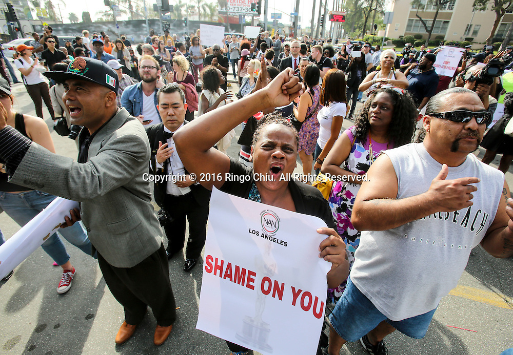Demonstrators shout slogans during a rally and march circle to protest the all-white slate of Oscar acting nominees and calling for more diversity in the entertainment industry, Sunday Feb. 28, 2016 in Los Angeles.(Photo by Ringo Chiu/PHOTOFORMULA.com)<br /> <br /> Usage Notes: This content is intended for editorial use only. For other uses, additional clearances may be required.