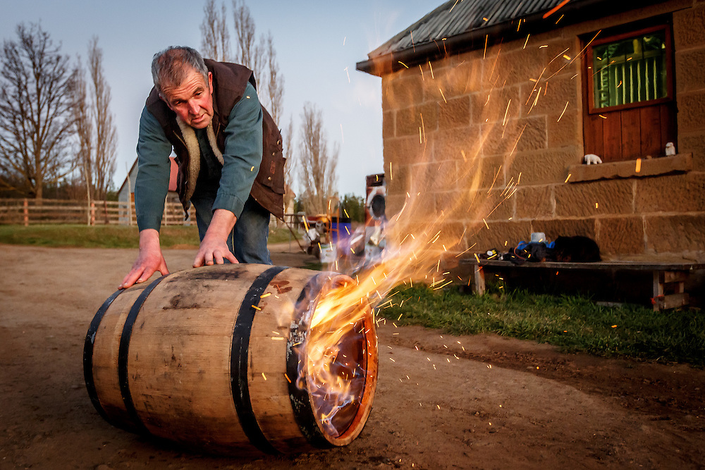 Distillery owner Peter Bignell chars the inside of a barrel at Belgrove Distillery in Kempton, Tasmania, August 25, 2015. Gary He/DRAMBOX MEDIA LIBRARY