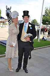 LORD & LADY GRIMTHORPE at the Investec Derby at Epsom Racecourse, Epsom Downs, Surrey on 4th June 2011.