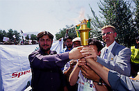 AFGHANISTAN.Kabul, 23 August 2005.Disability National Games, torch run from Darul Aman to Ghazi Stadium..Nasurullah Izat (left) National Director of SOA, Athletes and Troy W. Greisen Senior Vice President of Special Olympics International are holding the torch in Darul Aman