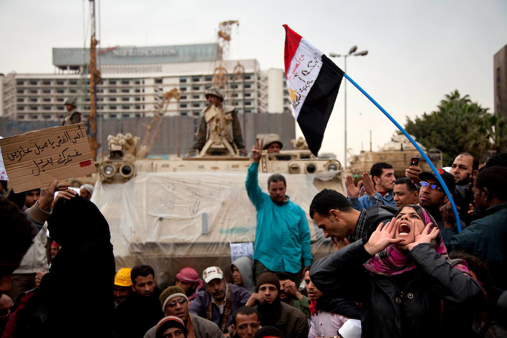 Anti-government protestors gather in Tahrir Square in Cairo, Egypt, on Monday, Feb. 7, 2011. Protesters gathered around army vehicles to prevent the army from moving towards the square and installing barbed wires.