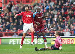 LONDON, ENGLAND - Saturday, March 5, 2011: Charlton defender Miguel Angel Llera protests as Tranmere Rovers' Enoch Showunmi scores to make it 1-0 during the Football League One match at The Valley. (Photo by Gareth Davies/Propaganda)