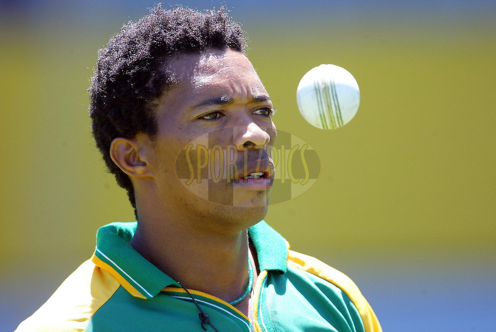 13 February 2004, International one day cricket, Eden Park, Auckland, New Zealand. Match 1 in series of 6, New Zealand vs South Africa..Makhayh Ntini..Pic: Andrew Cornaga/Photosport