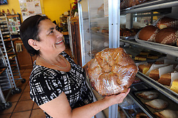 Proprietor Isobel Santos works on a display in the front of La Soledad Bakery at 617 E. Alisal St. in Salinas.