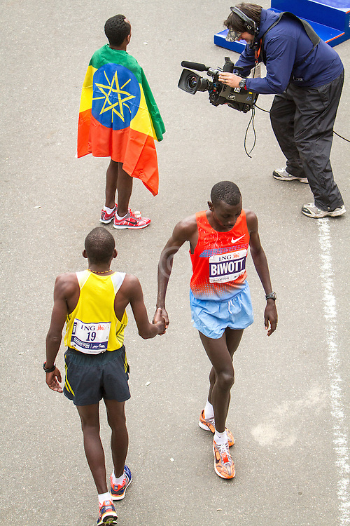 ING New York CIty Marathon: post race elites, Arile and Biwott, Kebede with flag