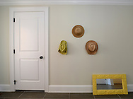 Southampton, NY:  Friday, June 1, 2012--  Repurposed hats serve as an interior decorating motif on the wall of this Southampton estate.     ©Audrey C. Tiernan