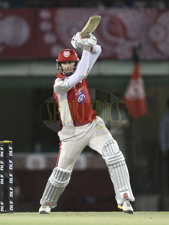 Kins XI Punjab captain David Hussey plays a delivery through the covers during match 25 of the the Indian Premier League (IPL) 2012  between The Kings X1 Punjab and The Royal Challengers Bangalore India held at the Punjab Cricket Association Stadium, Mohali on the 20th April 2012..Photo by Shaun Roy/IPL/SPORTZPICS
