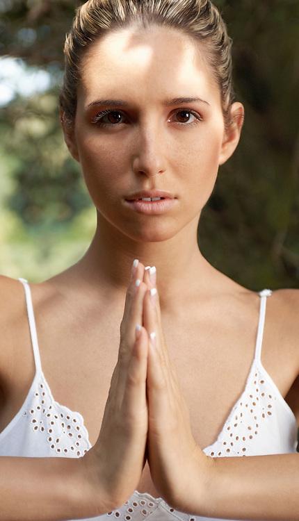 Woman meditating portrait